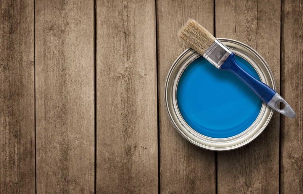 Paint can on the old wooden background
